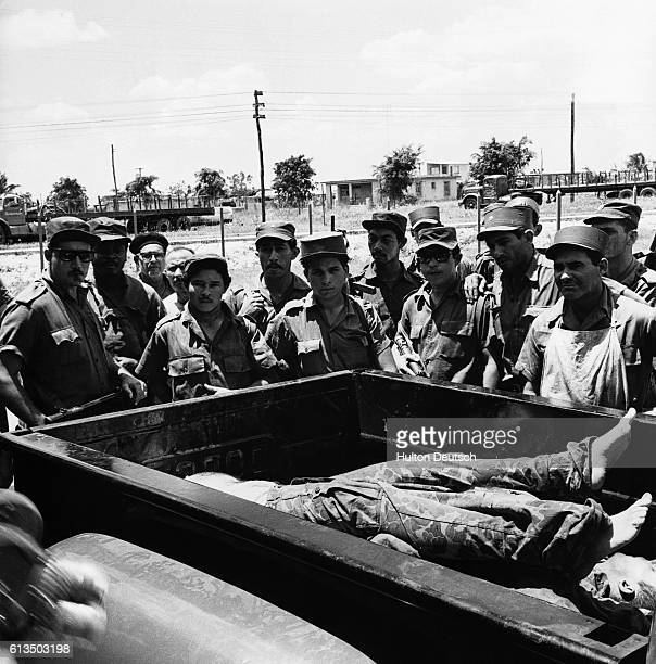 Cuban soldiers stand around a wagon carrying a dead soldier probably an American involved in the Bay of Pigs invasion of 1961   Location Playa De...