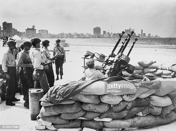 Cuban soldiers stand by an anti-aircraft artillery at the Havana waterfront in response to warning of an invasion from the United States.