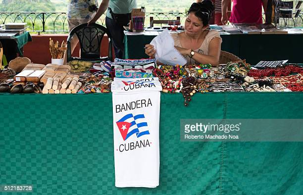 Cuban souvenirs stall Woman selling from the famous Cuban cigars till TShirts with the Cuban flag