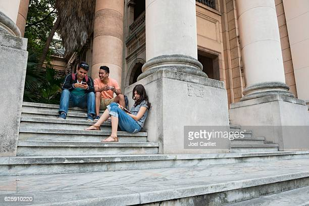 cuban students at the university of havana - university of the west indies stock photos and pictures