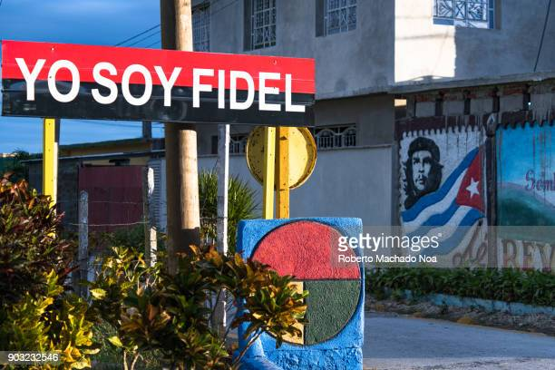 Cuban symbols and signs on a city corner: 'Yo Soy Fidel' newly installed sign