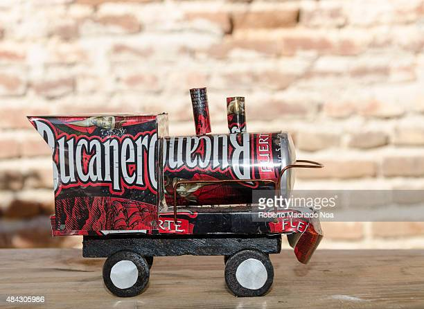Cuban tourism industry A toy train engine created from a Bucanero beer can from Cuba Beer cans are shaped into several objects sold to tourists as...