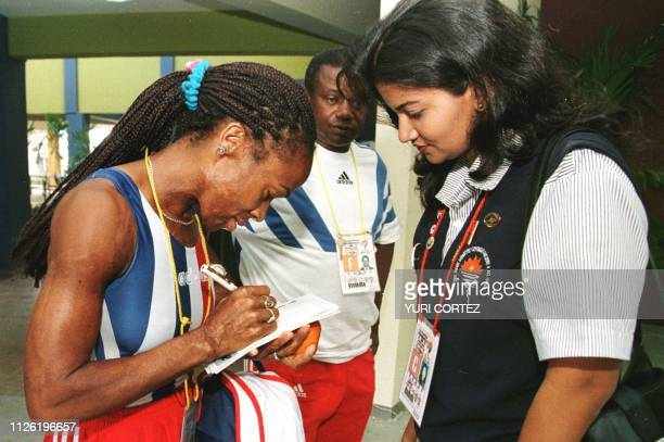 Cuban track star Ana Fidelia Quirot signs an autograph 08 August in the Olympic Village of the Central American and Carribean Games in Maracaibo...