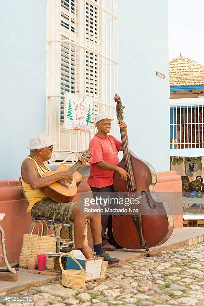 Cuban traditional musicians playing son for tourists in Trinidad which is the eight village founded in Cuba by Spanish colonizers and a UNESCO world...