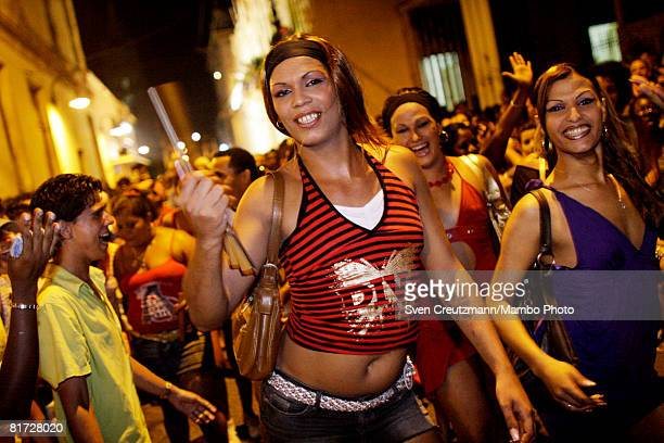 Cuban transvestites dance as conga groups march through the streets during the Camaguey carnival June 24 2008 in Camaguey Cuba The first day...