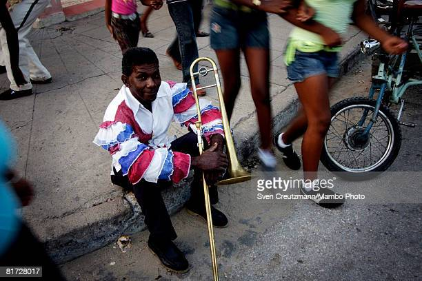 Cuban trumpet player rests during the Camaguey carnival June 25 2008 in Camaguey Cuba The first day celebration of the Camaguey St John Holiday...