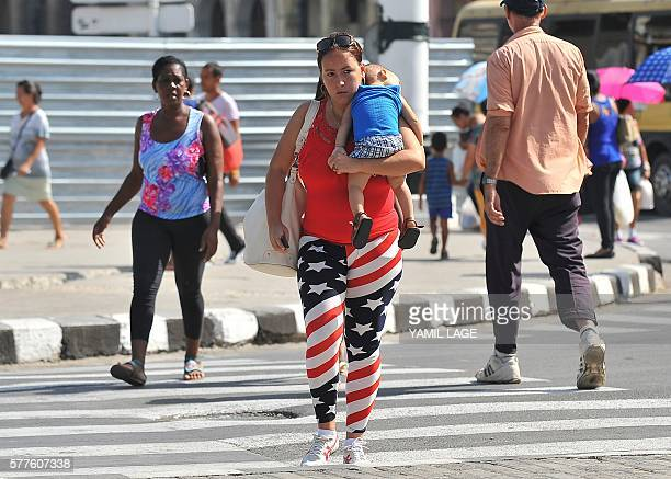 CUBAEEUU EL PRIMER ANO DE UNA RELACION SIGNADA POR LA SOSPECHAA Cuban walks in a street of Havana dressed with US symbols on July 19 2016 A year...