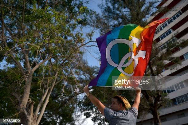 Cuban waves the rainbow flag at the gay pride parade during the celebration of the day against homophobia and transphobia in Havana, on May 12, 2018.