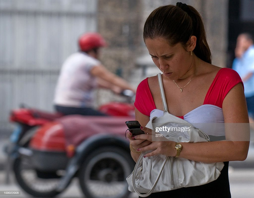A Cuban woman uses her mobile phone in a street of Havana on May 20, 2010.