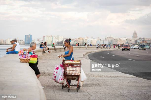 Cuban women sell sweets and toys at the Malecon in Havana, Cuba