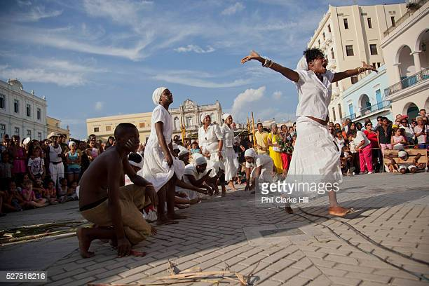 Cuban womn of African descent dancing smiling as part of a performance Performance in Havana old town local dance and theatre group enacting the...