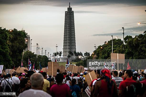 Cuban workers attend May Day celebrations at Revolution Square in Havana on May 1 2013 AFP PHOTO/ADALBERTO ROQUE
