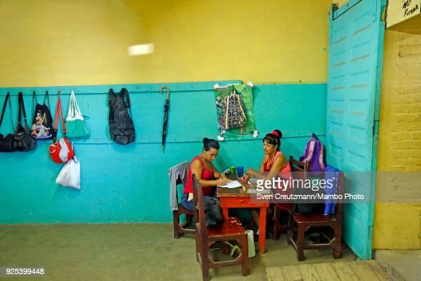 Cuban workers carry out administrative tasks at the Despalillo factory in the Western province of Pinar del Rio in San Juan y Martinez on February 27...
