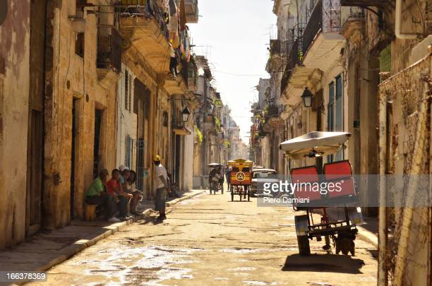 CONTENT] Cuban workers having a rest in one of Havana decaying streets