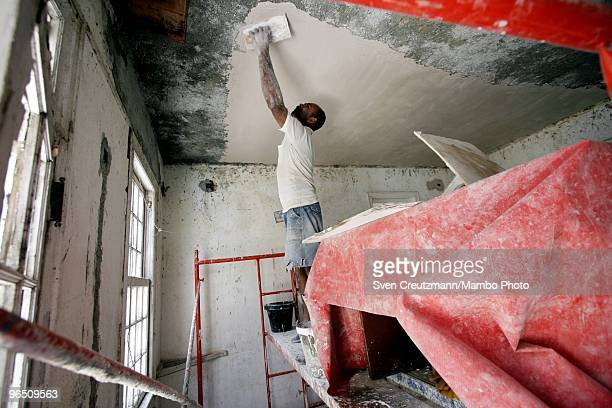 Cuban workers restore the ceiling of Ernest Hemingway�s house at the Finca Vigia on March 29 2006 in Havana Cuba The Hemingway Finca Vigia now turned...