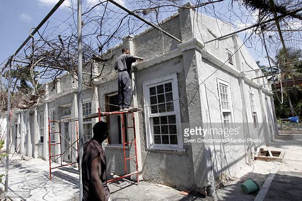 Cuban workers restore the façade of Ernest Hemingway�s house at the Finca Vigia on March 29 2006 in Havana Cuba The Hemingway Finca Vigia now turned...