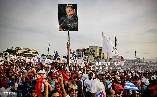 Cuban workers show a portrait of former President Fidel Castro during May Day celebrations at Revolution Square in Havana on May 1 2013 AFP...