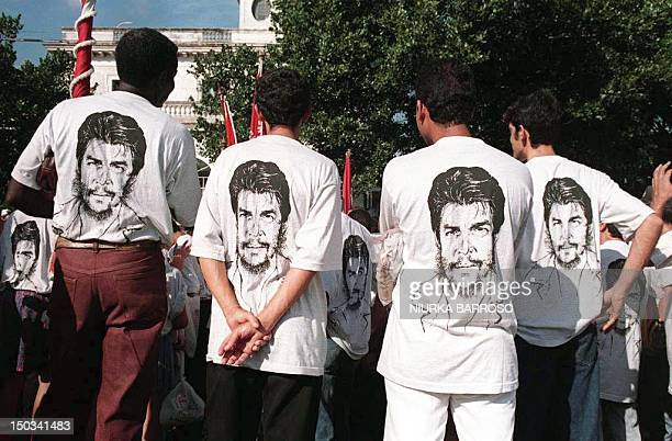 Cuban workers wearing 'Che' Guevara tee shirts prepare to take part in the traditional May Day celebrations in downtown Havana 01 May Cuba also...