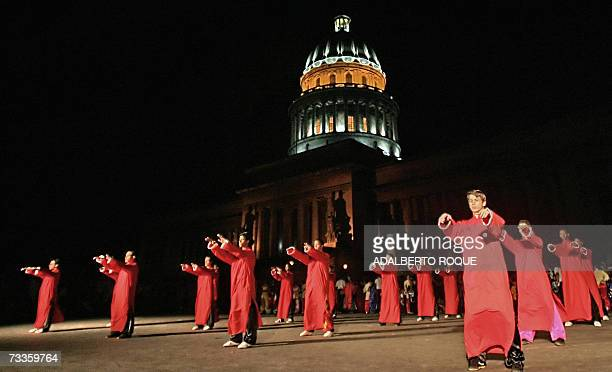 Cuban Wushu students perform in front of the Cuban National Capitol 17 February 2007 to celebrate the Chinese Lunar New Year of the Pig The world can...