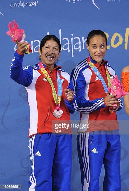 Cuban Yaima Mena and Annia Rivera pose on the podium with the bronze medal of the women´s 10m synchronised platform during the XVI Pan American Games...