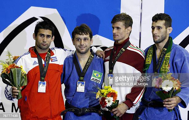 Cuban Yordanis Arencibia Brazilian Joao Derly Hungary's Miklos Ungvari and Iranian Arash Miresmaeili celebrate on the podium after the men's 66kg...