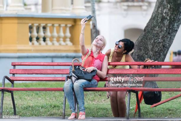 Cuban youth lifestyle connecting to internet through wifi in the Leoncio Vidal Plaza