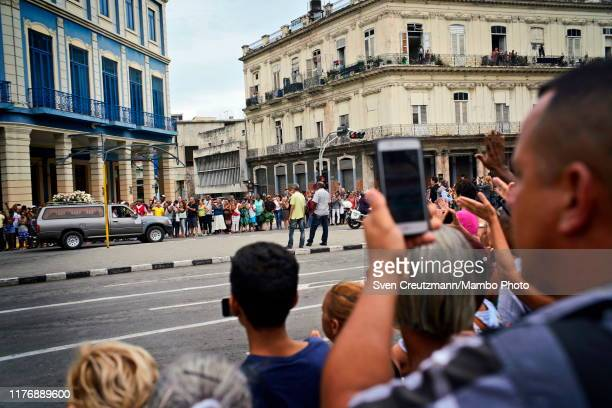 Cuban youth stand guard next to the open casket with the body of Cubas late Ballet legend Alicia Alonso being displayed in the lobby of the Gran...