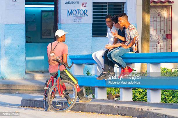 Cuban youth with bottle of rum in the early morning Alcoholic drinks are very easy and cheap to buy anywhere in the Caribbean Island