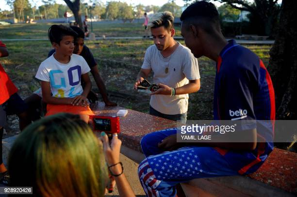 A Cuban youtuber records a magician's performance for her youtube channel in Havana on February 26 2018 Cubans don't have internet access at their...