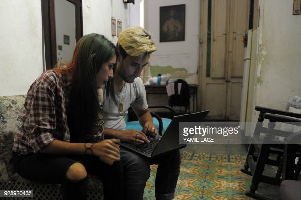 Cuban youtubers prepare their youtube program in a house of Havana on February 26 2018 Cubans don't have internet access at their homes yet the...