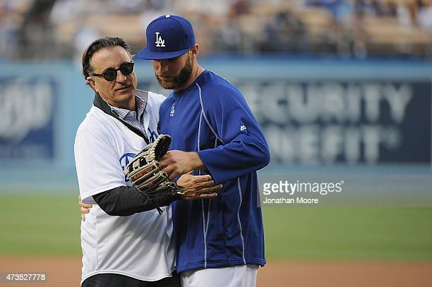 CubanAmerican actor Andy Garcia on the field with Yasmani Grandal of the Los Angeles Dodgers after throwing an honorary pitch for Cuban Heritage Day...