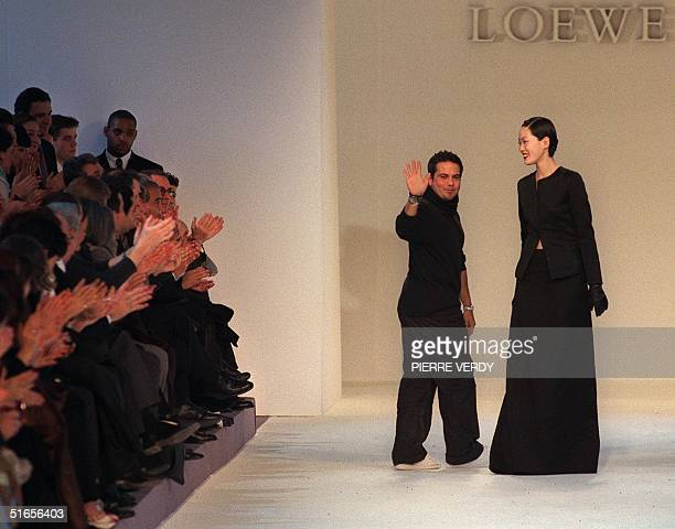 CubanAmerican designer Narciso Rodriguez acknowledges the audience after his show for Loewe during the 19992000 AutumnWinter readytowear collections...