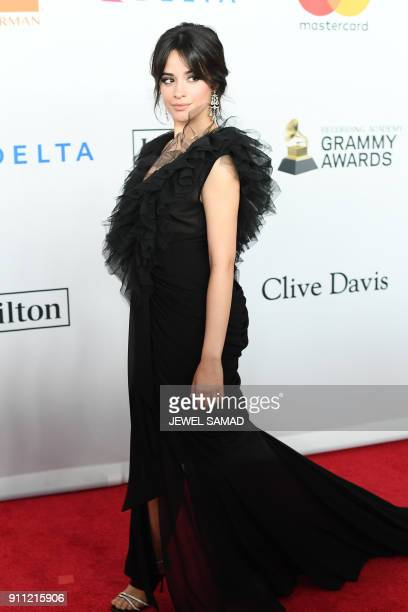 CubanAmerican singer and songwriter Camilla Cabello arrives for the traditionnal Clive Davis party on the eve of the 60th Annual Grammy Awards on...