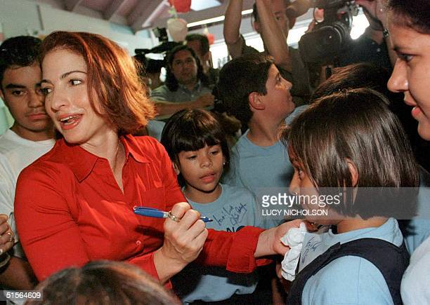 CubanAmerican singer Gloria Estefan signs autographs during a visit to a specialcare treatment center for elementary school children in Glendale...