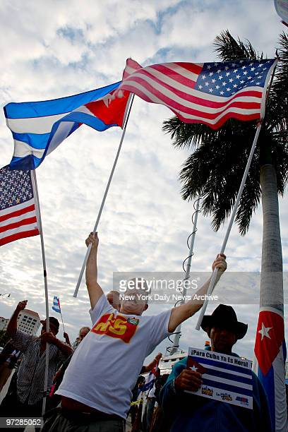 CubanAmericans fly Cuban and American flags as they gather in the Little Havana section of Miami Fla to celebrate the news that Fidel Castro has...