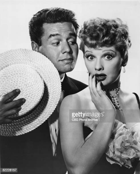 Cuban-born actor and musician Desi Arnaz looks at his wife, the American actress Lucille Ball , as she expresses surprise in a publicity still for...