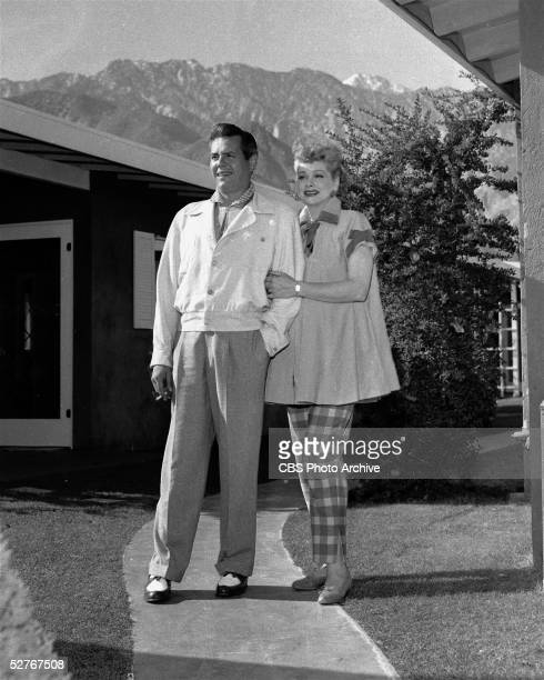Cuban-born actor, comedian, and musician Desi Arnaz stands with his pregnant wife, American actress and comedian Lucille Ball as she lovingly holds...