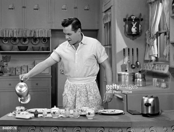 Cuban-born American actor and musician Desi Arnaz , as Ricky Ricardo, pours a cup of coffee in the kithcen in a scene from an episode of the...