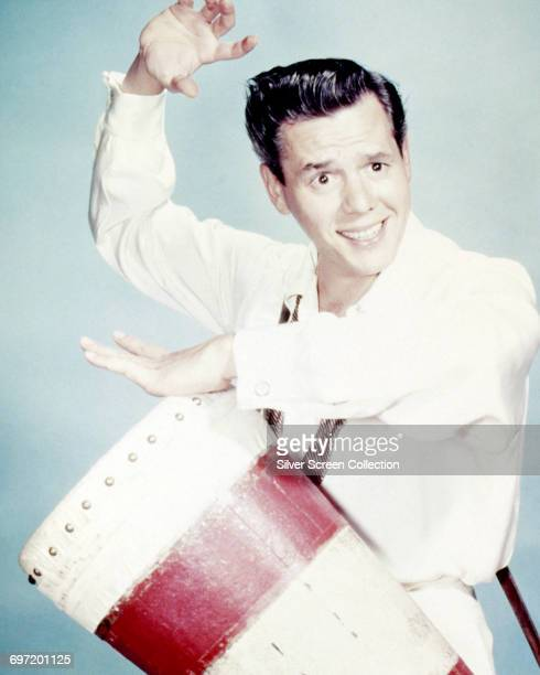 Cuban-born American actor, producer and musician Desi Arnaz on the drums, circa 1945.