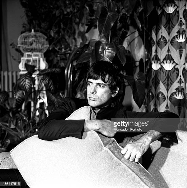Cuban-born American actor Tomas Milian sitting in his house in the district Prati. Rome, 1967.