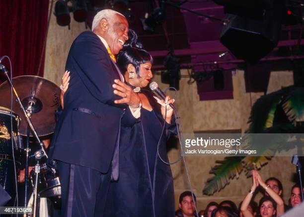 Cubanborn American salsa singer Celia Cruz and her bandleader and husband Pedro Knight perform at SOB's nightclub New York New York November 17 1997