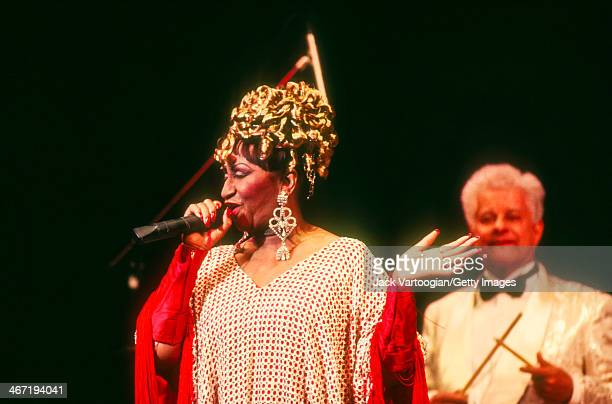 Cuban-born American salsa singer Celia Cruz performs, with bandleader Tito Puente , during a Jazz at Lincoln Center concert at Alice Tully Hall, New...