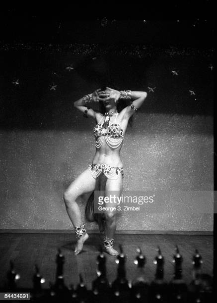 Cubanborn Isabella Garcia better known as Chelo Alonso hides her face while performing a seductive dance at an unidentified New Orleans venue 1955...