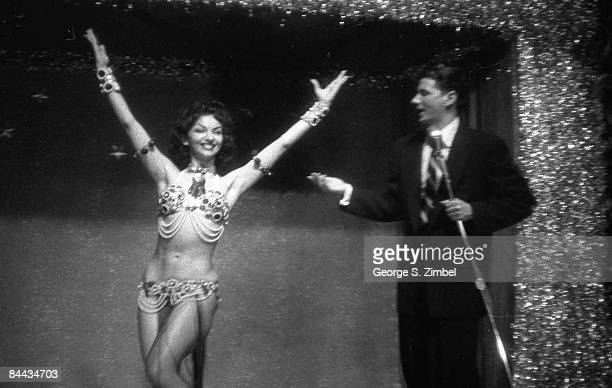 Cubanborn Isabella Garcia better known as Chelo Alonso smiles as she raises her arms while sharing the stage with the emcee at an unidentified New...