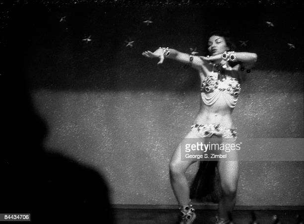Cubanborn Isabella Garcia better known as Chelo Alonso waves her hands while performing a seductive dance at an unidentified New Orleans venue...