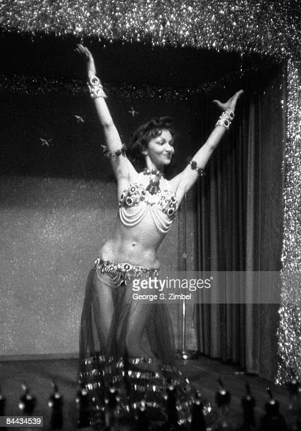 Cubanborn Isabella Garcia better known as Chelo Alonso with her hands up while dancing at an unidentified New Orleans venue 1955 United States