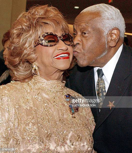 Cubanborn singer Celia Cruz is kissed by her husband Pedro Knight as they arrive at the 2002 Latin Recording Academy Person of the Year Award tribute...