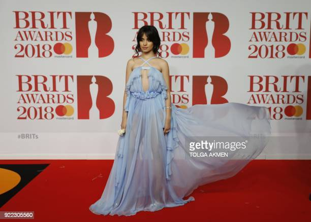 Cubanborn singersongwriter Camila Cabello poses on the red carpet on arrival for the BRIT Awards 2018 in London on February 21 2018 / AFP PHOTO /...