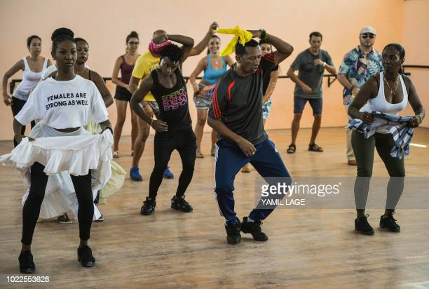 Cubans and tourists take a Rumba masterclass in Havana on August 22 2018 The Rumba a mix of African and Spanish culture considered by UNESCO an...