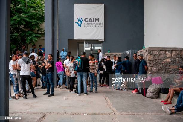 Cubans are pictured waiting outside of the Centro de Attention Integral de Migrantes office to register for their numbers to cross into the United...
